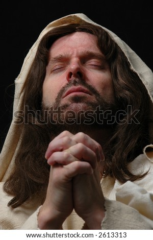 Portrait of Jesus in prayer with dark background