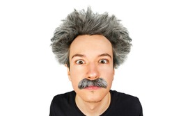 Portrait of jocular aging guy with grey long hair sticking his tongue out in Einstein manner. Isolated on background.