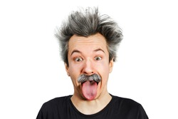 Portrait of jocular aging man with grey long hair sticking his tongue out in Einstein manner. Isolated on background.