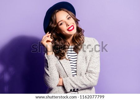 Portrait of joyful brunette woman with white teeth holding strand of hair looking at camera, isolated on violet background, having fun pleasure. Vacation weekend rest relax concept
