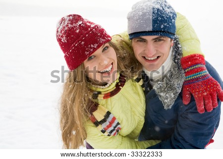 Portrait of joyful couple having a fun outdoor in winter