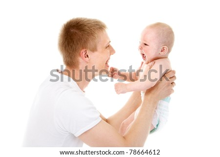 Portrait of joyful father playing fun with his baby