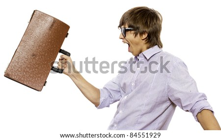 Portrait of joyful man brandishing his suitcase