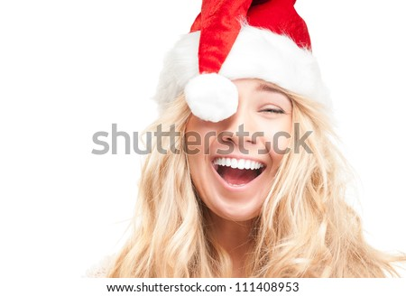 Portrait of joyful pretty woman in red santa claus hat laughing isolated on white background. Beautiful girl looking happy and excited. Happy Christmas and New Year holidays full of fun. stock photo