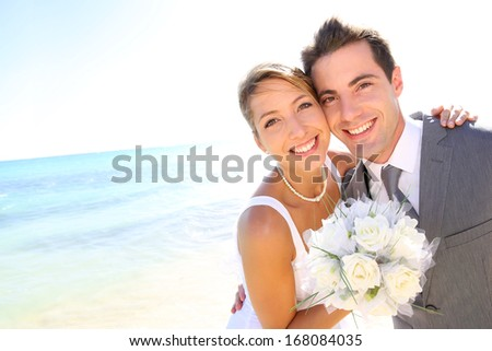 Portrait of just married couple by the beach