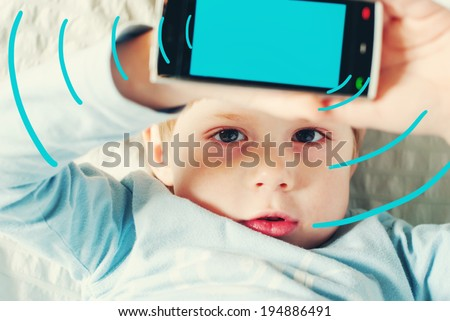 Portrait of Kid with Red Eyes Shows Untoward Influence From Smartphone, toned image with digital graphics