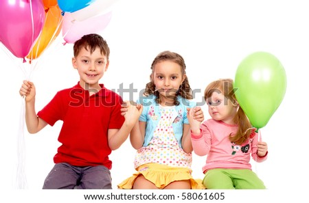Portrait of kids with colorful balloons during birthday party