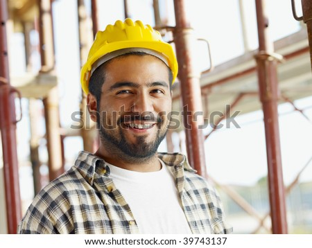 portrait of latin american construction worker, looking at camera