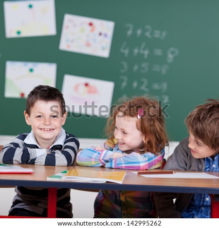 Portrait of laughing children sitting at the classroom