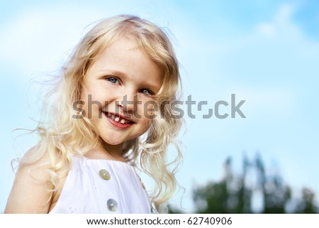 portrait of laughing little girl outdoor