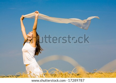 Portrait of laughing woman holding a silk cloth outdoor