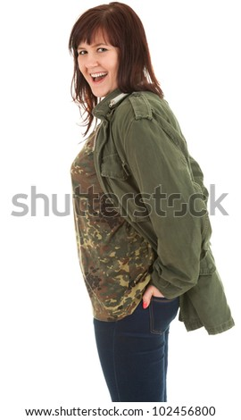portrait of laughing young woman in military jacket, white background