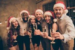 Portrait of leaning guy and ladies enjoy christmas night celebrate x-mas noel give toast screaming wearing dress shirt cap pants in house with newyear illumination decoration indoors