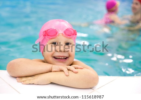 Portrait of little baby swimming  in swimming pool