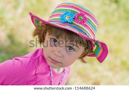 Portrait of Little  Beautiful Baby Girl in summer hat.