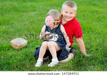 portrait of little boy and girl outdoors