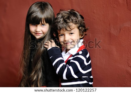 portrait of little boy and girl outdoors in autumn