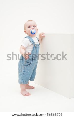 portrait of little boy in jean dungarees