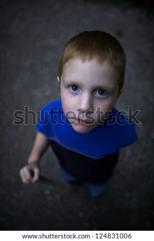 Portrait of little boy looking up