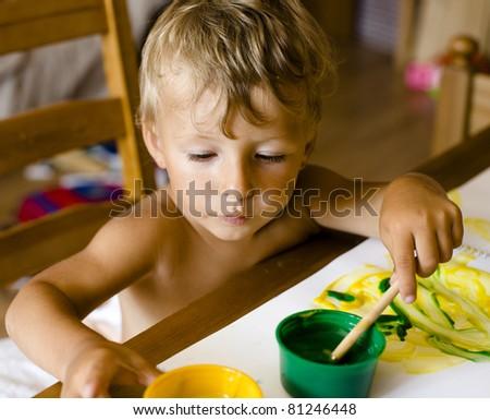 portrait of little boy painting