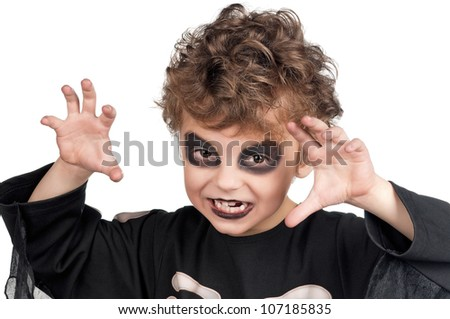 Portrait of little boy wearing halloween costume on white background