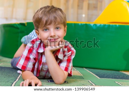Portrait of little boy with beautiful blue eyes