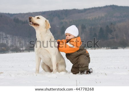 Portrait of little boy with dog