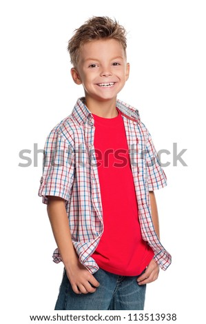 Portrait of little boy with hands in pockets isolated on white background