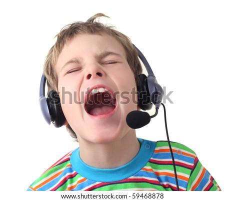portrait of little boy with headphones and microphone singing with closed eyes, isolated on white