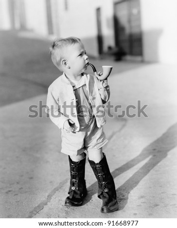 portrait of little boy with pipe
