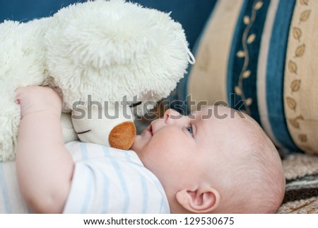 Portrait of little cute baby big bear toy and stripes shirt