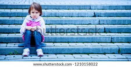 Portrait of little cute child girl expressing sadness and loneliness. Gestures, body language, facial expressions, depression concept. #1210158022