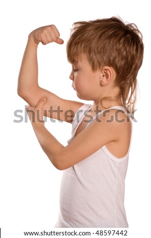 Portrait of little european boy flexing biceps. Beautiful caucasian model. Isolated on white background.