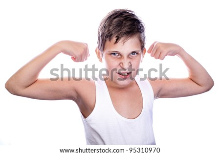 Portrait of little european boy flexing biceps. Isolated on white background