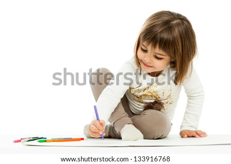Portrait of little girl drawing with wax crayons.isolated on white.