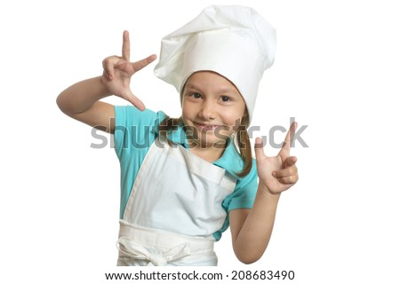 Portrait of little girl in chef uniform showing fingers