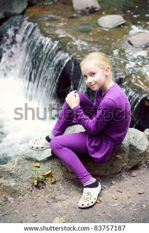 Portrait of Little Girl in Park