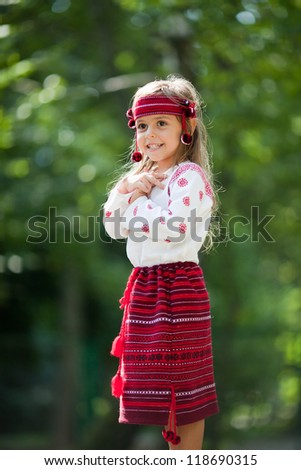 Portrait of little girl in Ukrainian national costume