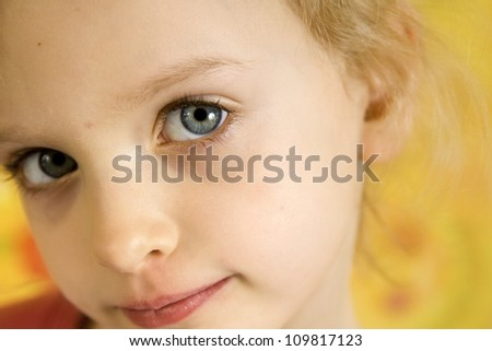 Portrait of little girl on a yellow floral backgound