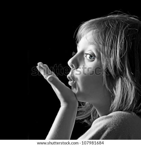 portrait of little girl  on dark background