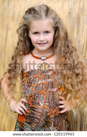 portrait of little girl outdoors in jungle