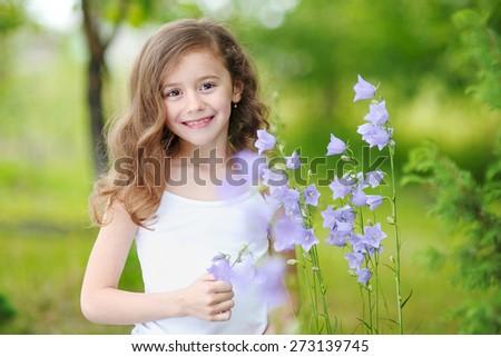 portrait of little girl outdoors in summer #273139745