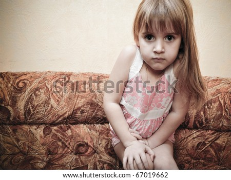 Portrait of little girl playing and imagine she is a model