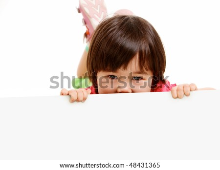 Portrait of little girl playing hide and seek