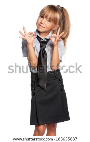 Portrait of little girl showing ok sign isolated on white background