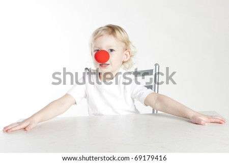 portrait of little girl with a clown nose