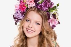 Portrait of little girl with flower wreath