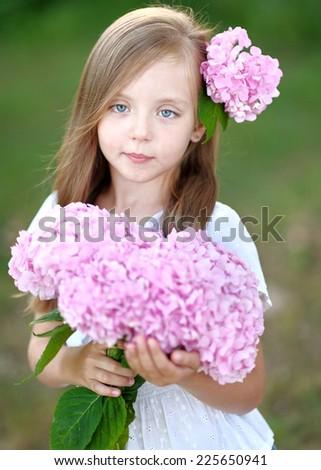 portrait of little girl with flowers hydrangea #225650941