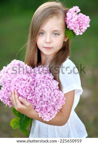 portrait of little girl with flowers hydrangea #225650959