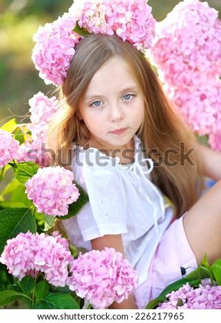 portrait of little girl with flowers hydrangea #226217965